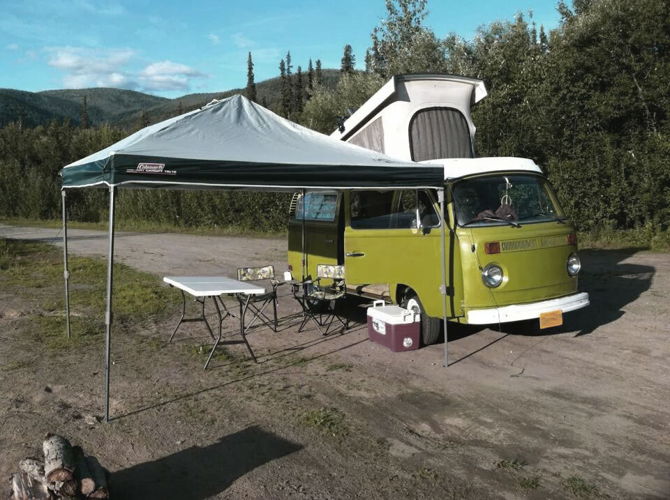 Coleman canopy tent next to VW Bus