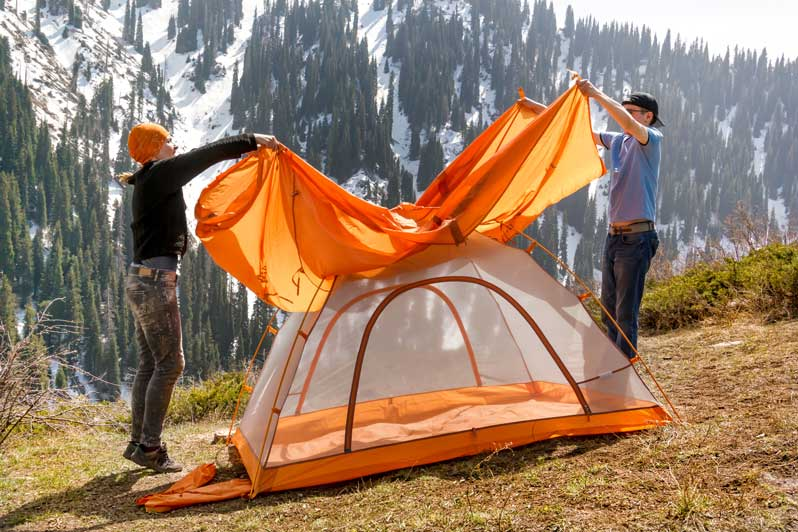 Setting up tent rain fly